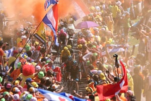 <strong>Stage Twenty</strong><br>Stage Location: Modane Valfrejus to Alpe D'Huez<br>Stage Winner: Thibaut Pinot<br>Ritchie Porte and Wout Poels lead the yellow jersey of Chris Froome through the mayhem on Dutch corner