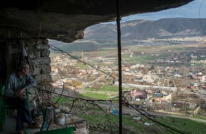 This file photo taken on 13 December 2018, shows one of the last residents of historical caves overlooking the Hasankeyf valley