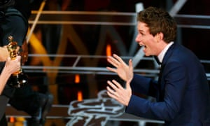 Eddie Redmayne reacts as he takes the stage to accept the Oscar for best actor for his role in The Theory of Everything