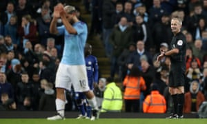 Referee Martin Atkinson looks on as Manchester City's Sergio Aguero is substituted.