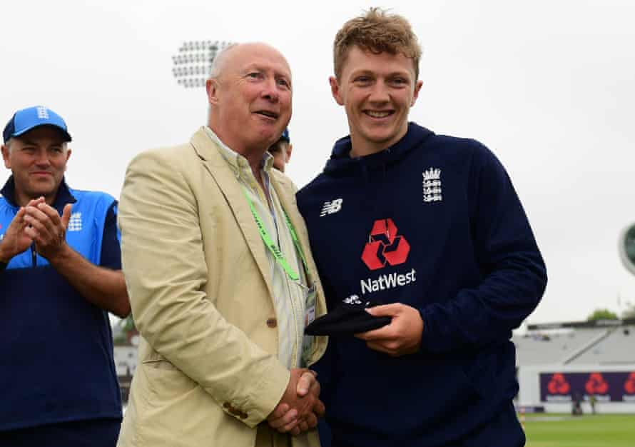 Vic Marks hands Dom Bess his first test cap before the game against Pakistan at Lord's in May 2018.