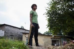 Boxer Miki Ndaya outside her home in the neighbourhood of Messina, Kinshasa