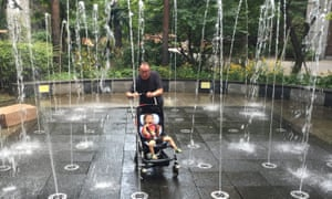 Splashing time ... Ian Martin plays with his grandson Monty