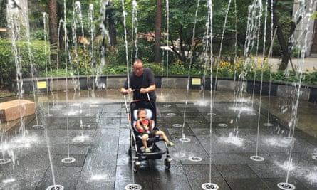 Splashing time ... Ian Martin plays with his grandson Monty