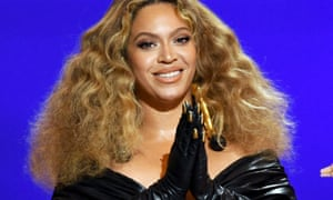 Beyoncé at the Grammys in Los Angeles wearing gloves with gold nails stuck to the outside.