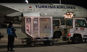 Containers of a second batch of Covid-19 vaccines, ordered from Chinas Sinovac Biotech Ltd., are being unloaded upon arrival at Istanbul Airport on January 25, 2021 in Istanbul, Turkey.