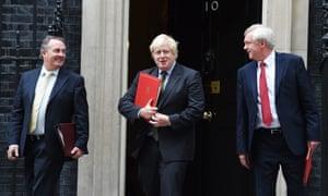 Liam Fox, Boris Johnson and David Davis leave 10 Downing Street.