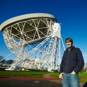 Professor Brian Cox stood outside at Jodrell Bank Observatory, Cheshire, UK.