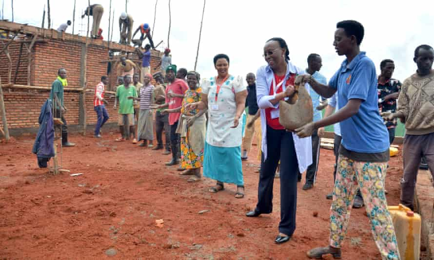Marguerite Barankitse takes part in constructing a workshop at Mahama camp