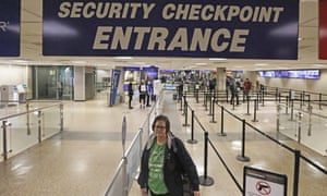 Ann Lovell stands at the security checkpoint before her flight from Salt Lake City International Airport to San Diego. Lovell travels every few months to Tijuana, Mexico, to buy medication for rheumatoid arthritis – with tickets paid for by the state of Utah's public insurer.