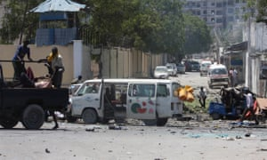 Somali security forces evacuate the injured from the scene of an explosion after a suicide bomber blew up his explosives-laden vehicle near the education ministry headquarters in Somali capital Mogadishu on April 14, 2015.