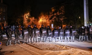 Police officers stand guard as protesters gather for the rally against a ban on movements which was extended by the government to curb the spread of the novel coronavirus pandemic in Ljubljana, Slovenia on 5 November 2020.