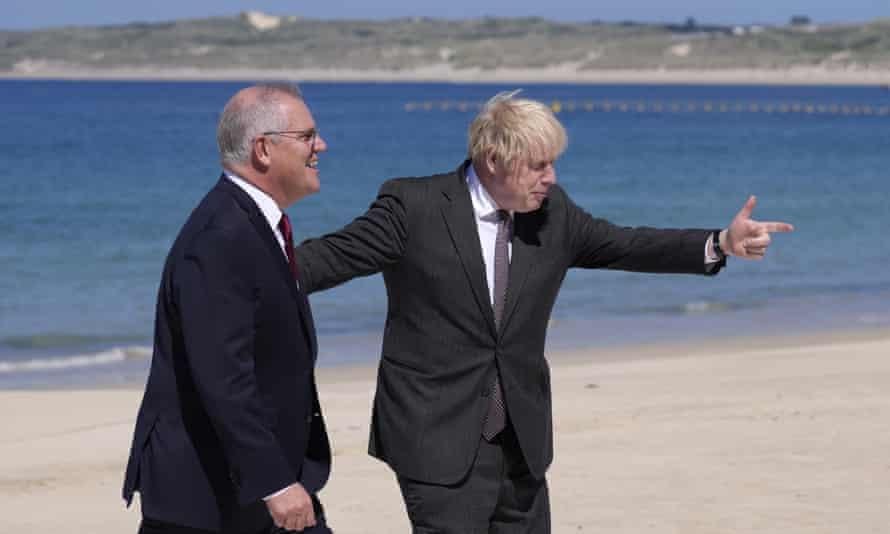 British Prime Minister Boris Johnson, right, greets Australia's Prime Minister Scott Morrison