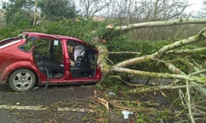 A car damaged by a tree which left two men injured, on the A49 north of Church Stretton in Shropshire, as flights have been cancelled and commuters were warned they faced delays after Storm Doris reached nearly 90mph on its way to batter Britain. PRESS ASSOCIATION Photo. Picture date: Thursday February 23, 2017. See PA story WEATHER Storm.