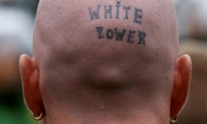 A man with 'white power' tattooed on the back of his shaved head