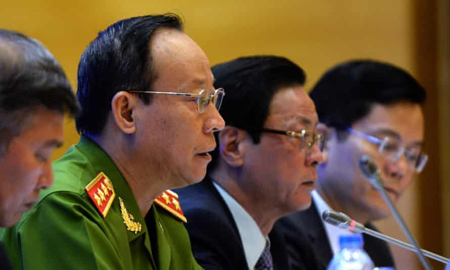Vietnam's Deputy Minister of Public Security, Le Quy Vuong (2nd from left), speaks during a press conference on the presidential amnesty decision made to mark the 70th anniversary of the foundation of Vietnam's communist regime.