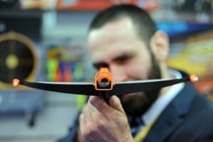 Johnny Disco, of TKC Sales, shows a Petron Stealth sucker dart crossbow