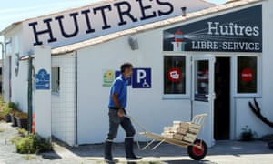 Aquaculturist Tony Berthelot arrives with oysters in front of l'huîtriere de Re, where his automatic oyster vending machine is located