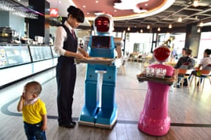 Novelty value … a couple of AI waiters, Little Blue and Little Peach, at a robot-themed restaurant in Yiwu.