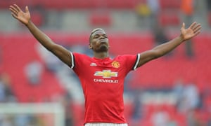 Paul Pogba celebrates in front of the Manchester United fans at the final whistle.