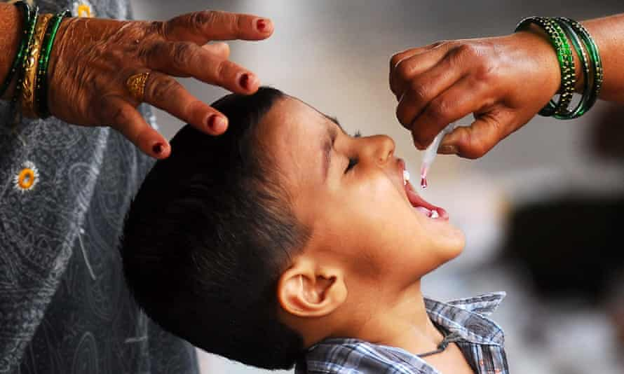 A boy in vaccinated for polio in Mumbai