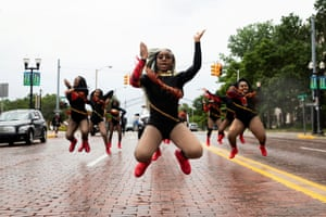 """Dance captain Shair'Mae Harris, 17, leads members from """"For The Love of Dance Studio"""" during a parade to celebrate Juneteenth in Flint, Michigan"""