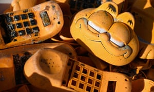 Spare parts of plastic Garfield phones on the beach in Plouarzel, Brittany
