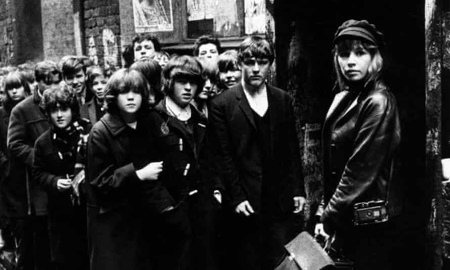 Astrid Kirchherr outside the Cavern Club in Liverpool, 1964.