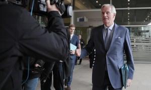 Michel Barnier speaks to the media outside the EU headquarters in Brussels