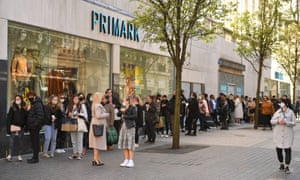 Customers queuing to enter a re-opened Primark clothes shop in Liverpool, north west England, on Monday April 12 as lockdown measures eased.