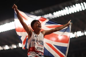 Thomas Young of Great Britain celebrates after winning gold in the men's 100m T38.