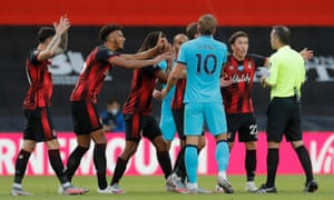Bournemouth players surround the referee in protest at a decision.