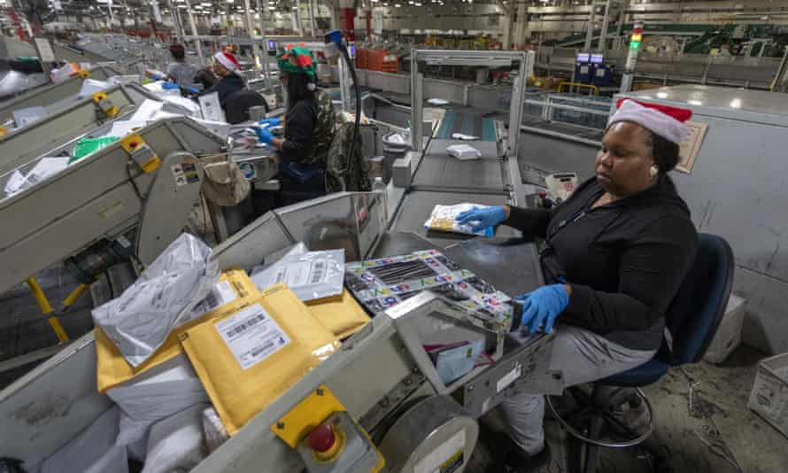 US postal service workers scan parcels at the Los Angeles processing and distribution center on 11 December 2019 in Los Angeles, California.