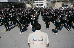 In eastern Gaza City, a counsellor from Maan development centre, a Unicef partner, leads recreational activities for students at Shuje'iyah Girls' School, pictured in September 2014
