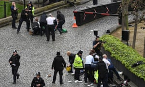 Emergency services at the scene outside the Palace of Westminster where police officer Keith Palmer was fatally stabbed by Khalid Masood