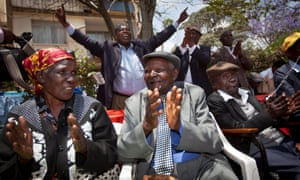 Kenyans celebrate a ruling in their favour during a previous hearing on the compensation case for Mau Mau veterans.
