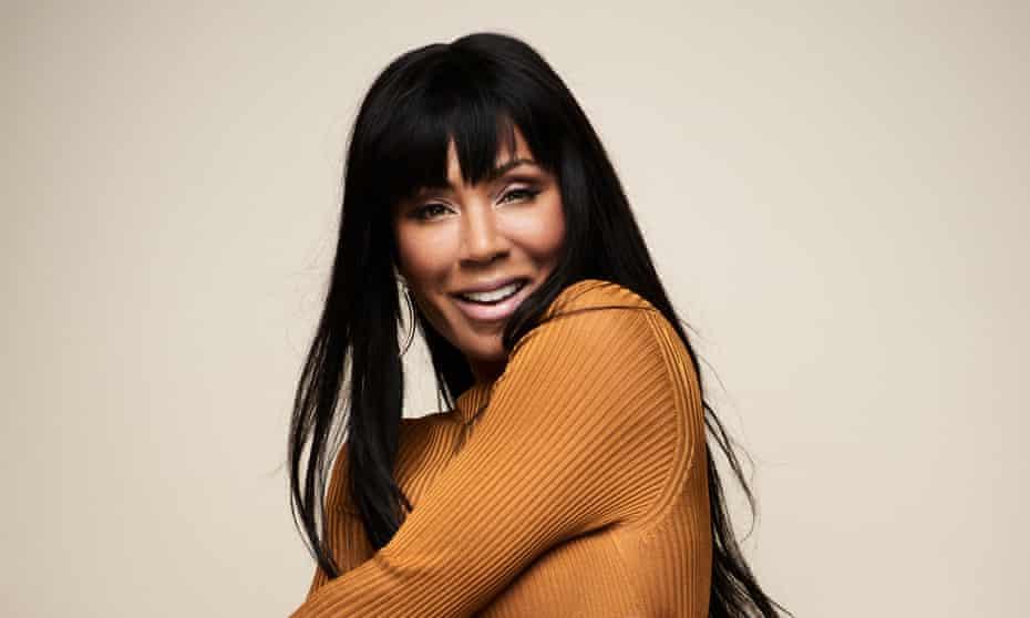Jada wears roll-neck by versace.com; body suit worn underneath by nubianskin.com.
