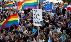 A demonstrator holds a placard reading 'I fear fascism' at a protest in Warsaw against violence that took place against the LGBT community in Białystok