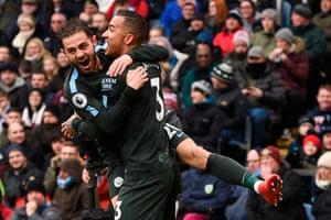 Manchester City's Bernardo Silva celebrates with Danilo after Danilo scored the opening goal.
