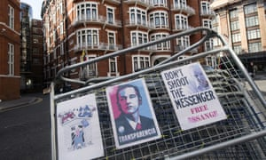 Signs outside the Ecuadorean embassy in London where Julian Assange is living.