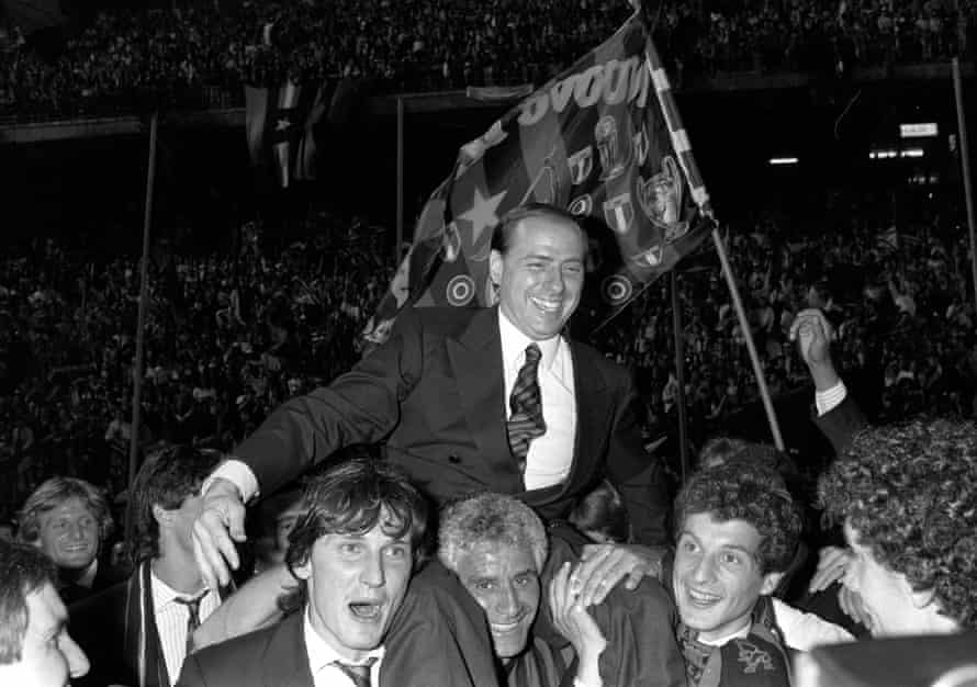 Milan president Silvio Berlusconi is carried away by his players after winning Serie A in 1988 at the San Siro.