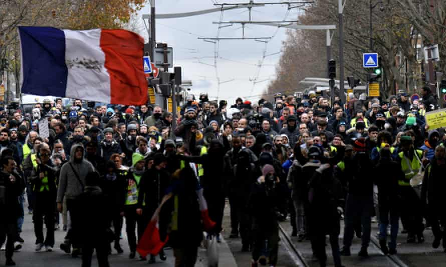 Protesters gather for a demonstration in Paris on Saturday
