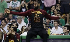 LeBron James watches from the bench as the Cavaliers' hopes of beating the Celtics in Game 5 evaporate