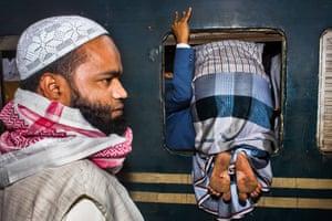 "Open Travel and 2nd, Bangladesh National Award: Md Enamul Kabir""The Last Train"" Image Description: এটা ছিল ১৩।০১।২০১৭ সকাল কামালাপুর রেল স্টেশান, ঢাকা, বাংলাদেশ। ইস্তেমাতে যাবার জন্য সবাই ট্রেনের পিছনে ছুটতে ছিল। স্বাভাবিক দিনে ট্রেন এ তেমন বেশি ভিড় হয় নাহ কিন্তু ওইদিন অনেক ভিড় ছিল কারন ট্রেন কম ছিল ইস্তেমার পথে। একজন যাত্রী জানালা দিয়ে ঢুকার চেষ্টা করতেছিল কারন সে দরজা দিয়ে যেতে পারতেছিল না। আর তখন আমি ছবিটা তুলি Copyright:"