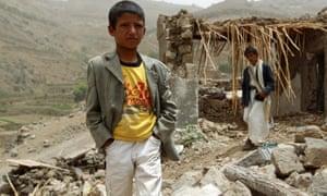 yemen boy rubble