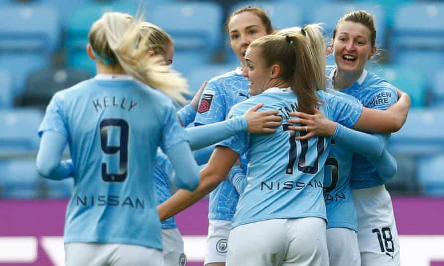 Ellen White is congratulated by her teammates after scoring Manchester City's second goal