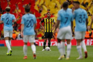 Watford captain Troy Deeney looks dejected after Manchester City's sixth goal.