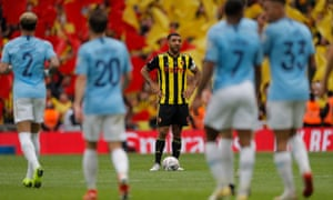 Watford captain Troy Deeney looks down on Manchester City's sixth goal.