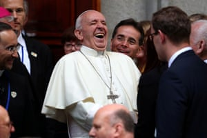 Pope Francis laughs as he leaves St Mary's Pro Cathedral during his visit to Dublin, Ireland, 25 August
