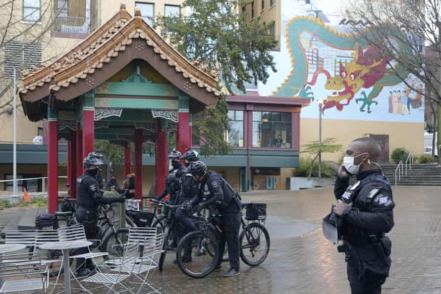 Seattle police officers begin their patrols in Seattle's Chinatown-International district.